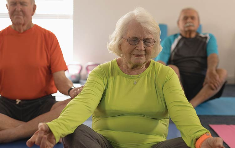 Tricia Hughey at Yoga Daily on Riviera Drive in Mount Pleasant suggests yoga as a form of exercise for seniors due to its slower pace and its effectiveness with improving joint stability, mobility and strength