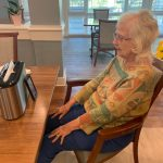 Mount Pleasant Gardens - connecting seniors. A woman connects with her hubby using the FaceTime app.